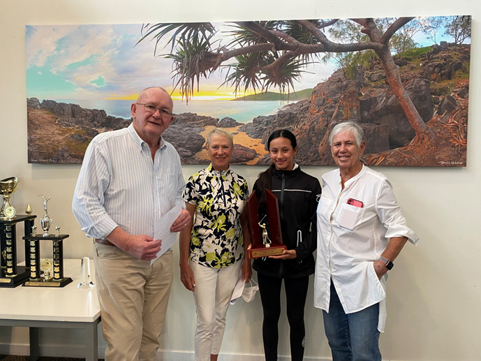 Junior Girl's Champion Ionna Muir being presented recently with her trophy by the Club President with the Sponsor of this event, Cheryl Powell